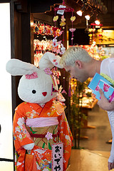 Joey bowing before a Bunny dressed as a Geisha
